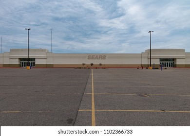 SAINT CLOUD, UNITED STATES - May 30 2018: A closed Sears retail store, located at Crossroads Center mall, sits vacant. The building is stained with the Sears logo.
