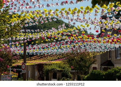 Saint Cyprien, France - September 4, 2018: Colorful street decorations during the summer Felibree in Saint Cyprien, France. A felibree is a traditional Occitan festival .