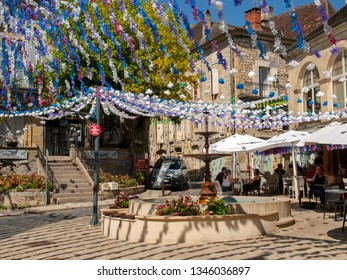 Saint Cyprien, France - September 4, 2018: Colourful street decorations during the summer Felibree in Saint Cyprien, France. A felibree is a traditional Occitan festival