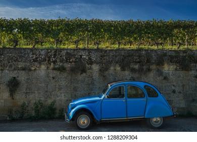 Saint Emilion , France , October 12 2018 Blue Citroën 2CV  parked by the side of the road