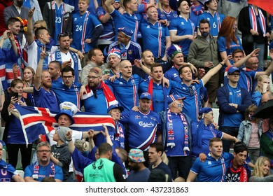 SAINT ETIENNE- FRANCE,JUNE 2016:fans and supporterson the stands in football match  of Euro 2016 in France between Portugal vs Iceland at the stade geoffroy guichard on June 14, 2016 in Saint Etienne