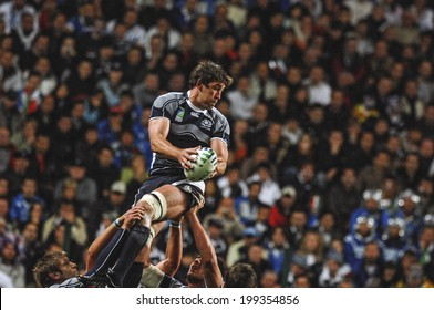 SAINT ETIENNE FRANCE-SEPTEMBER 30, 2007: scottish player catches the ball in touche, with fans seated in the background, during the match France vs Ireland, of the Rugby World Cup, in Saint Etienne,