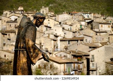 Saint Francis statue over an italian town background - Scanno - L'Aquila - Abruzzo