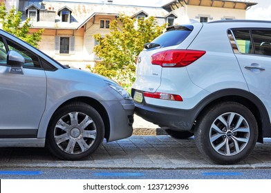 SAINT GERVAIS - AUGUST 6: Two cars parked in the street of Saint Gervais, France on August 6, 2015.