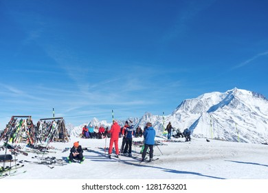 SAINT GERVAIS-LES-BAINS, FRANCE - FEBRUARY 25, 2017: skiers taking a break at the summit of Plaine-Joux (1920m) to admire the Mont Blanc in the background.