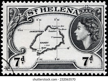 SAINT HELENA - CIRCA 1953: A stamp printed by ST. HELENA (GREAT BRITAIN) shows Image Portrait of Queen Elizabeth II and Map of Saint Helena, circa 1953