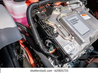 SAINT IVES, CAMBRIDGESHIRE, UK - CIRCA APRIL 2017: Detailed view of a new generation hybrid vehicle engine showing the electrical generator and other associated components.