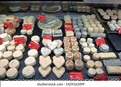 Saint Jean de Luz, France - May 24, 2019: cheese stand in covered market hall on weekly market day