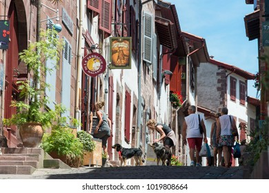 SAINT JEAN PIED DE PORT, FRANCE - JULY 3, 2016: people walking through one of the most tourist streets in the village.