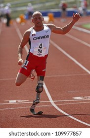 SAINT JOHN, CANADA - AUGUST 10: Canadian Paralympic amputee Earle Connor sprints at the North, Central American & Caribbean Masters Track & Field Championships August 10, 2012 in Saint John, Canada.