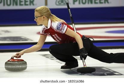 SAINT JOHN, CANADA - March 19: Russia's Alexandra Saitova delivers a stone at the Ford World Women's Curling Championship March 19, 2014 in Saint John, Canada.