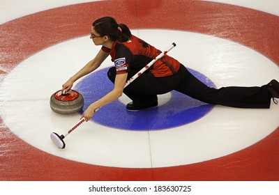 SAINT JOHN, CANADA - March 19: Canada's Lisa Weagle slides through the rings on a stone delivery at the Ford World Women's Curling Championship March 19, 2014 in Saint John, Canada.