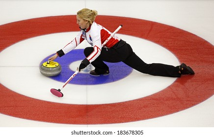 SAINT JOHN, CANADA - March 19: Christine Svensen of Denmark slides through the rings on her stone delivery at the Ford World Women's Curling Championship March 19, 2014 in Saint John, Canada.
