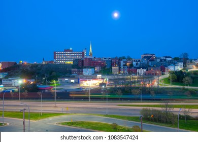 Saint John city skyline at night with full moon, Saint John, New Brunswick, Canada.