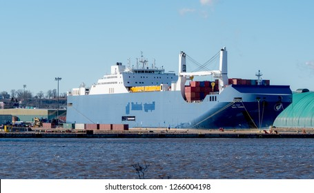"""Saint John, NB, Canada - December 23, 2018: The Saudi ship """"Bahri Yanbu"""" loads containers containing LAVs in Saint John. Canada is shelling LAVs to Saudi Arabia as part of a controversial arms deal."""