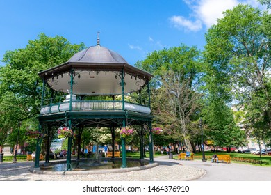 Saint John, NB, Canada - July 15, 2019: The bandstand at King's Square. Constructed in 1908, it hosts concerts in the summer. A fountain and pool of water are underneath. It is a popular tourist stop.