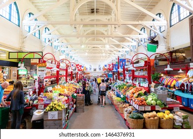 Saint John, NB, Canada - July 20, 2019: Inside the Saint John City Market. People are shopping for produce and arts and crafts. A national historic site, the market was completed in 1876.