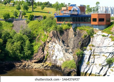 Saint John, NB, Canada - July 20, 2019: The Skywalk at the Reversing Falls hangs over the Saint John river. It has clear floor sections that allow visitors to look straight down at the river.