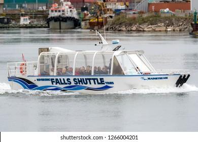 Saint John, NB, Canada - October 7, 2018: A tour boat filled with passengers tours Saint John Harbor and the Reversing Falls.