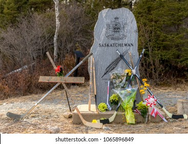 Saint John, New Brunswick, Canada - April 10, 2018: Hockey sticks and flowers at the Saskatchewan monument, left as a memorial to the hockey players killed in a collission in Saskatchewan.