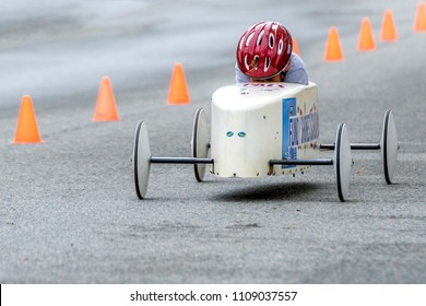 Saint John, New Brunswick, Canada - May 26, 2018: A closeup of a participant in the anual soap box derby. His helmet is almost touching the car so his face is not visible.