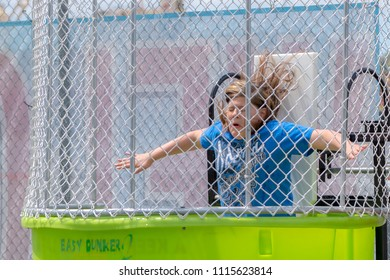 Saint John, New Brunswick, Canada - June 10, 2018: Port Saint John Community Day. A woman falls into a dunk tank.