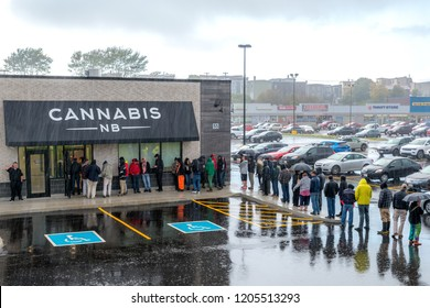 Saint John, New Brunswick, Canada - October 17, 2018: People waiting in pouring rain to purchase cannabis legally from a Cannabis NB store on the first day of legalization in Canada.
