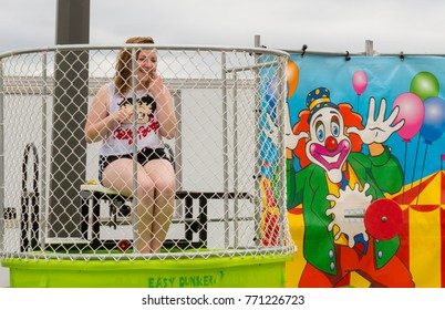 Saint John, New Brunswick, Canada - June 4, 2017: Community day at the port. A girl sits on the platform in a dunk tank.
