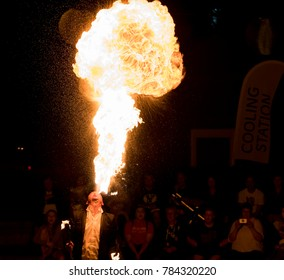 Saint John, New Brunswick, Canada - 2017-07-14: A man breathes fire at night, at the annual Buskers On The Boardwalk festival.