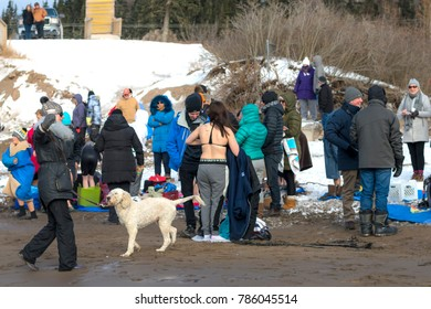 Saint John, New Brunswick, Canada - Janyary 1, 2018: People participate in the annual polar bear swim in the freezing coild Bay of Fundy.