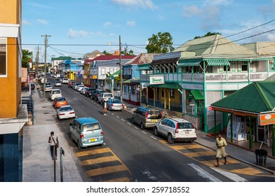 SAINT JOHN'S, ANTIGUA - AUGUST 24: downtown view of St Mary's street on August 24, 2011 in Saint John's, Antigua. It is the commercial centre of the nation and the chief port of the island of Antigua.