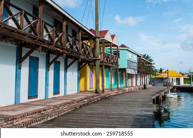 SAINT JOHN'S, ANTIGUA - AUGUST 24: wooden houses and pier at Saint John's Port on August 24, 2011 in Saint John's, Antigua. It is the chief port of the island of Antigua.