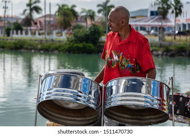 SAINT JOHN'S, ANTIGUA - FEBRUARY 8, 2018: Photo of an unidentified steel drum player in the waterfront area of this island capital, greeting arriving cruise ship passengers.