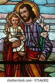 Saint Joseph holding baby Jesus
