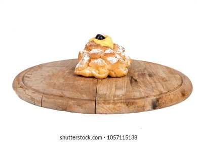 Saint Joseph's Zeppole composition in display on a wooden plate