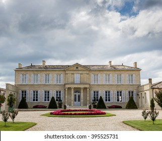Saint Julien, France - August 18, 2014: Chateau Branaire Ducru with dark clouds and garden in the Medoc.