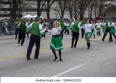 Saint Louis, MO—March 17, 2018, dancers in traditional Irish costumes dance with partners in the street during Saint Patrick's day parade