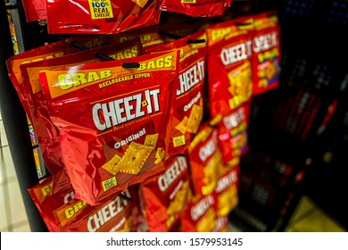 Saint Louis, MO—Dec 2, 2019; bags of Cheez-It cheese flavored crackers made by Kellogg's in flexible plastic pouch Grab Bag containers hanging on point of sale display at a retail location.