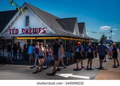 Saint Louis, MO—June 29, 2019; patrons standing outside in lines at service windows at Ted Drews frozen custard and ice cream shop on Route 66 in St. Louis Missouri during summer