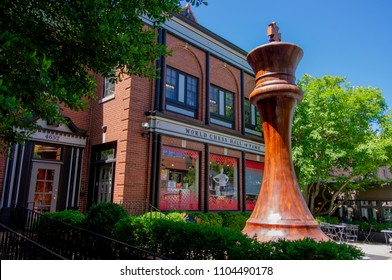 Saint Louis, MO—June 3, 2018; a giant wooden king chess piece sculpture stands outside a museum.  The World Chess Hall of Fame is based in St. Louis' Central West End district.
