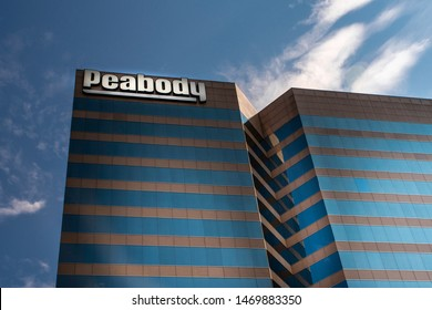 Saint Louis, Mo—Aug 3, 2019; bright white corporate logo hangs on building downtown identifying corporate headquarters of Peabody Energy one of the worlds largest coal mining companies.