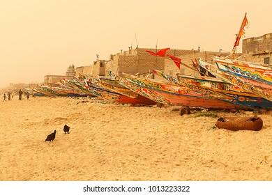 Saint Louis du Senegal,Senegal-April 19, 2014: Local fishermen moor their canoes on the beach on April 19, in Saint Louis du Senegal-Senegal.