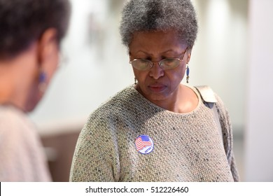 Saint Louis, MO - November 8, 2016: Voter with reflection on mirror looks down after casting vote during Presidential elections in Saint Louis, Missouri