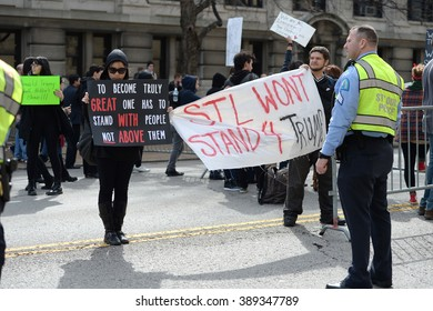Saint Louis, MO, USA - March 11, 2016: Protesters hold signs outside a Donald Trump rally in the Peabody Opera House in Downtown Saint Louis
