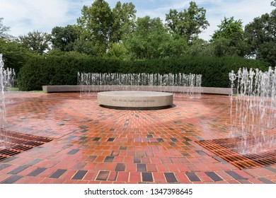 Saint Louis, MO / USA - September 14, 2016: The dancing water seems to quench the round stone seat at the A. Wessel Shapleigh Fountain at the MO Botanical Gardens, St. Louis , MO