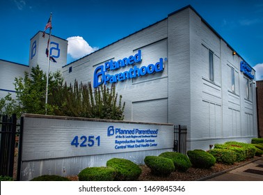 Saint Louis, MO--Aug 3, 2019; American flag on pole at building with Planned Parenthood logo in Central West End.  St Louis hosts the states only women's health clinic that can perform abortions