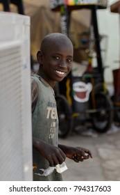 SAINT LOUIS, SENEGAL - APR 24, 2017: Unidentified Senegalese little boy smiles in Saint Louis, one of the major cities in Senegal