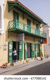 SAINT LOUIS, SENEGAL - MAY 29, 2014: Old colonial house and grocery store, in the historical center of the city