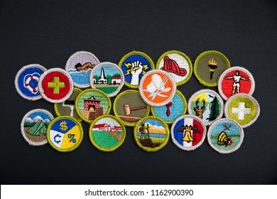 SAINT LOUIS, UNITED STATES - AUG 22, 2018:  Group of Boy Scouts of America (BSA) merit badges on black background