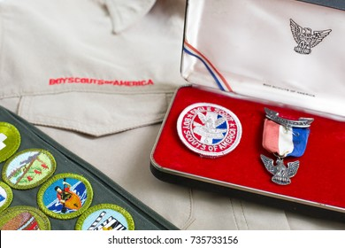 SAINT LOUIS, UNITED STATES - OCTOBER 16, 2017: Boy Scouts of America (BSA) eagle pin and patch with khaki uniform shirt and merit badge sash